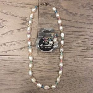A faux pearl necklace and matching earrings